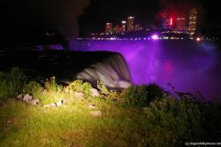 Niagara Falls at night during light show as seen from Terrapin Point.jpg