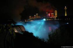 Niagara Falls at night light show in blue with Skylon Tower visible.jpg