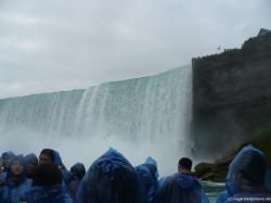 Canadian Flag and the Horseshoe Falls as viewed from Niagara Falls Maid of the Mist.jpg