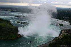 Photo of Horseshoe Falls with Toronto in the distance as viewed from Skylon Tower revolving restaurant.jpg