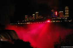 Red Light covers the Niagara Falls as night in light show.jpg
