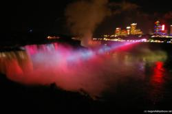 Changing colors of Niagara Falls at night light show now in red on Horseshoe Falls.jpg