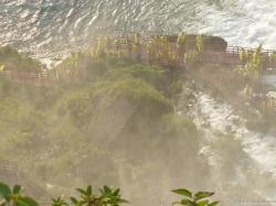 Tourists in yellow rain coats on the red staircases of the Bridal Veil Falls in Niagara Falls.jpg